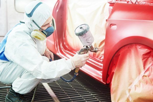Automotive collision centre spray painting service